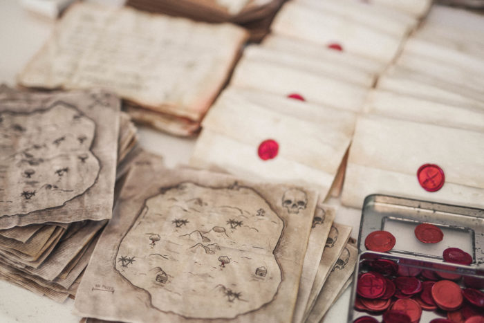 Pirate maps and wax seals for the Society of Curiosities mystery subscription box game.